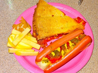 Backwards party food: apple sticks (backwards fries) with peanut butter dip instead of ketchup, pizza sandwiches and backwards hotdogs which involves slicing the weiner in half and attaching it to either side of the bun. Great ideas.