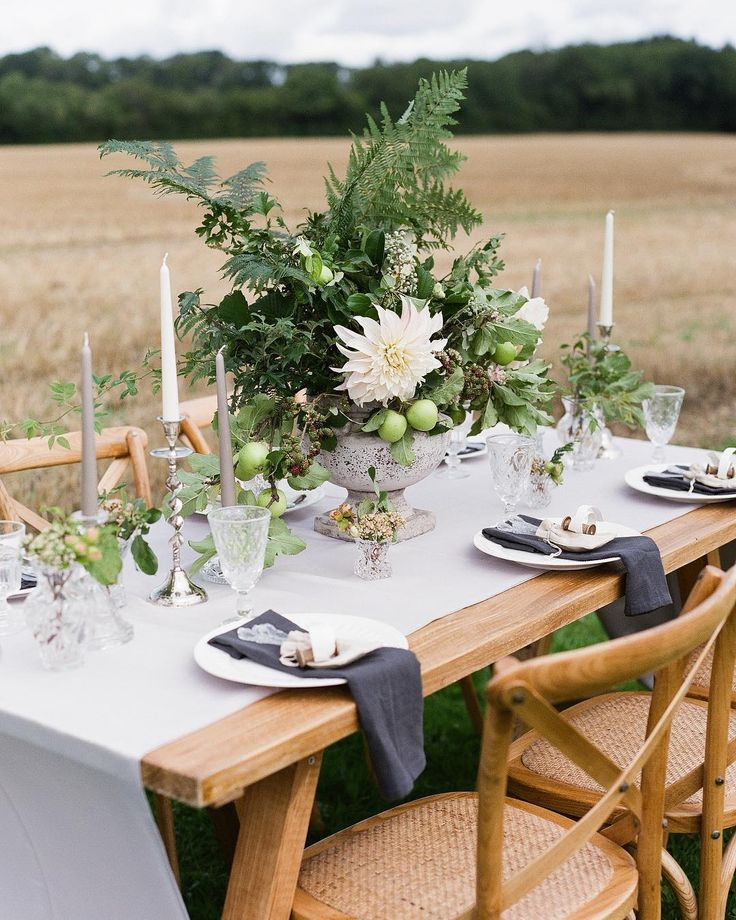 And another one from Old Romance an editorial in the beautiful hampshire countryside. A wild and wonderful arrangement for an outdoor setting. That dahlia just sings doesnt it?! __ The Team photography | @natasha_hurley floral design | @floribundaroseflorists design & styling | @thewstylist table & chair hire | @stressfreehire satin runner | @tabletodinefor