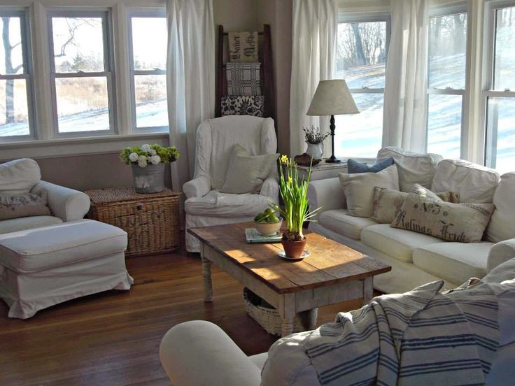 This living room is perfect. Tons of windows, neutral colors, and just overall simplw
