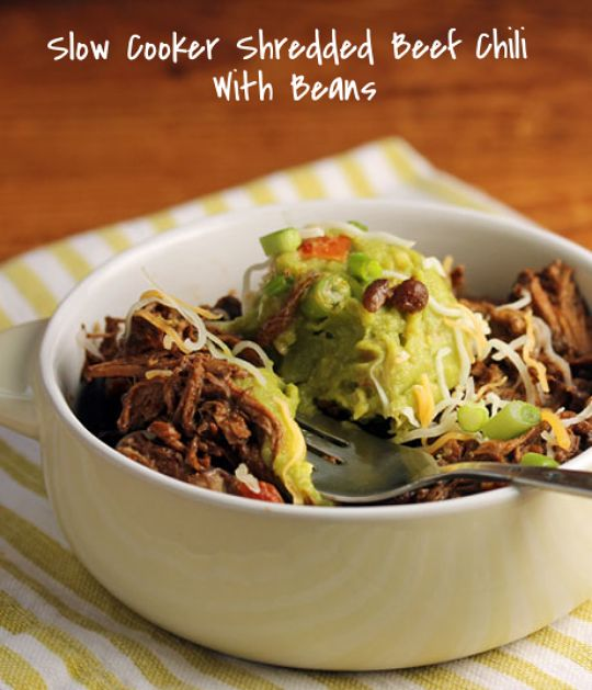 Slow cooker shredded beef chili with black beans, topped with ...