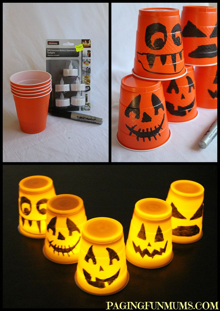 All you need are some orange plastic cups, a permanent marker and some battery operated tea lights.