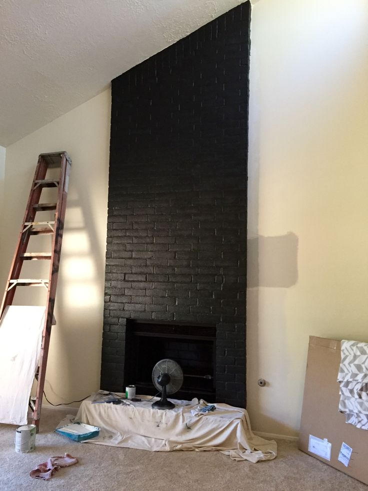 Satin black paint enlivens this brick fireplace!!