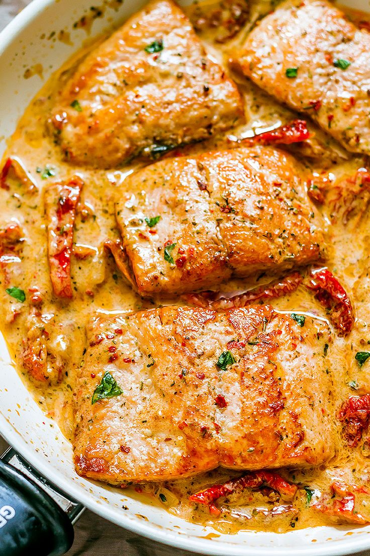 Pan-seared salmon with a sun-dried tomato cream sauce. Delectably healthy and ready in 20 minutes.