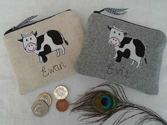 Here we have a handmade coin purse made using beautiful Laura Ashley oatmeal linen or grey wool with a cow design. It is available with a choice of fabric and a name/wording (up to 15 characters). If you would like extra wording other than the 15 characters, please contact me, as, for an extra charge, I can embroider more words on the back. The purse measures 12x10cm (big enough for bank cards) and has black and white dotty lining. Altogether this is a beautifully made item. I have more ...