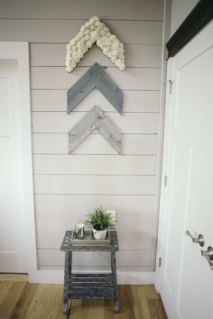 This rustic arrow set is the perfect addition to any wall in your home. The reclaimed pallet wood is stained a steel gray color. Covered in natural white sola wood flowers.   Each piece measure 18in x 12in & aprox 4 feet wide when put together. Includes mounting bracket on the back for easy hanging.