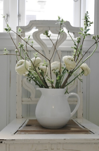 Old wooden chair makes a perfect spot for a pitcher with fresh flowers xxo.