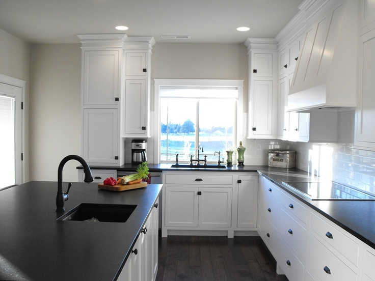 White Cabinetry Black Counters Greige Walls