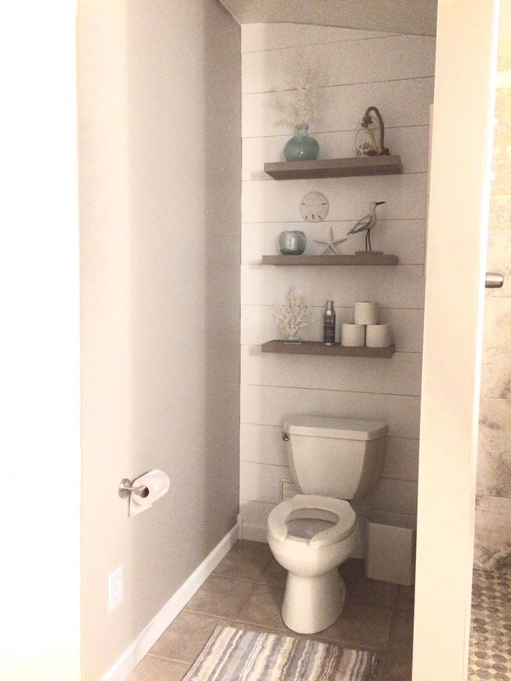 Simple And Smart Bathroom Hanging Shelf With Thick White Shelves And Ropes Bathroom Shelf Decor Diy Bathroom Storage Small Bathroom Storage