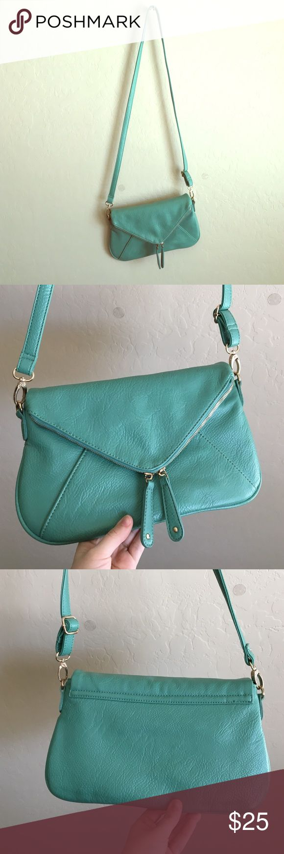 Cute light blue Urban Outfitters purse! Super cute, barely used. Small scuff from being hung on a purse hanger shown in last picture, other than that perfect condition. Kimchi Blue Bags