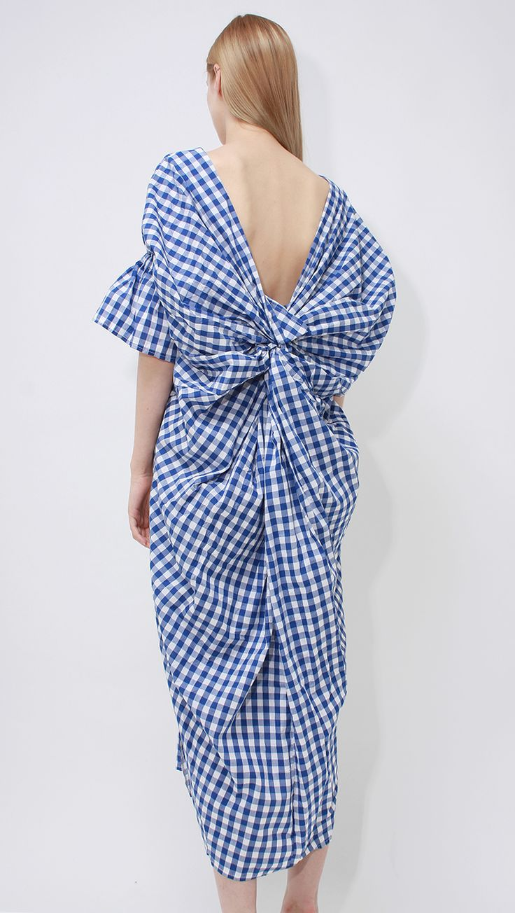 Margot Dress, a lightweight open back gingham dress in blue. Featuring a deep V-neckline, short ruched bell sleeves, open back with big knot details, side slant two pockets, slips-on and casual fit. W