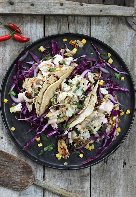 BAJA FISH TACOS. We couldn't go through Summer without bringing this back. Baja fish tacos are now the quintessential taste of California but originally they come from the northern-most state of Mexico. We've made them super healthy using beautiful flat head in a corn tortilla topped with a red cabbage slaw and a natural yogurt Baja sauce.   30 Minutes. Gluten free. 410 Calories.