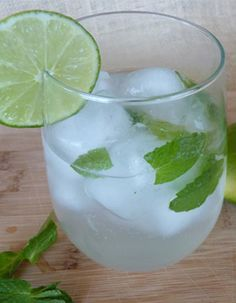 Coconut mojito - Ingredients:  •2 ounces Malibu Red  •1/2 a lime, squeezed  •2 tablespoons fresh mint  •Soda water  •Ice
