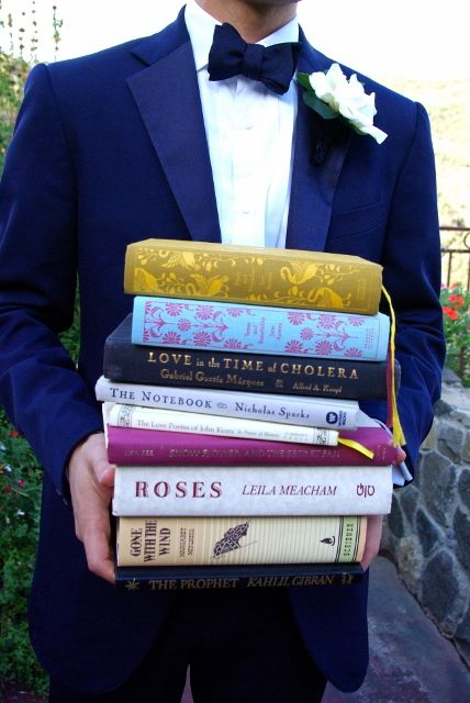 The bridsemaids give their favorite love story to the bride. Oh my gosh I want this! This is awesome for brides who love reading.
