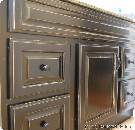 DIY:  Bathroom Cabinet Tutorial -  a dated oak finish cabinet is transformed with 2 Minwax products!!!  THE BEST & EASIEST cabinet facelift I've seen!