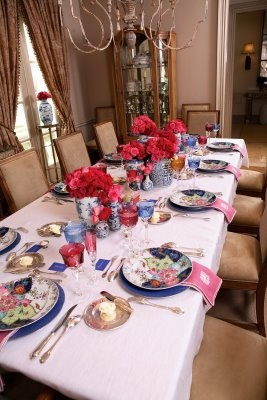 """Kimberly loves blue-and-white china, so when she was planning """"Baby Shower in Blue and Pink,"""" she started with a Porthault tablecloth. Since the luncheon was in Kimberly's dining room, she set the table with her blue-and-white china, layering the patterns. Asian jars were filled with roses and arranged into clusters. The china pattern is """"Tobacco Leaf,"""" by Mottehedah. The blue charger is also made by Mottehedah."""