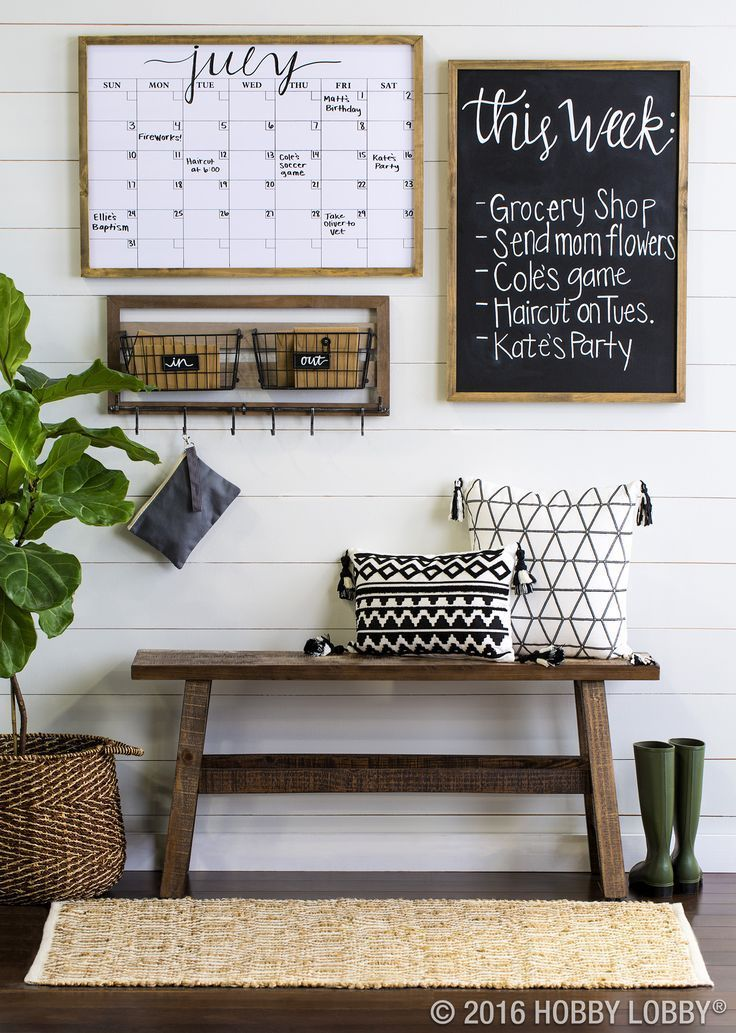 Living Room decor - rustic farmhouse style command center with wood bench, chalkboard and graphic baskets.