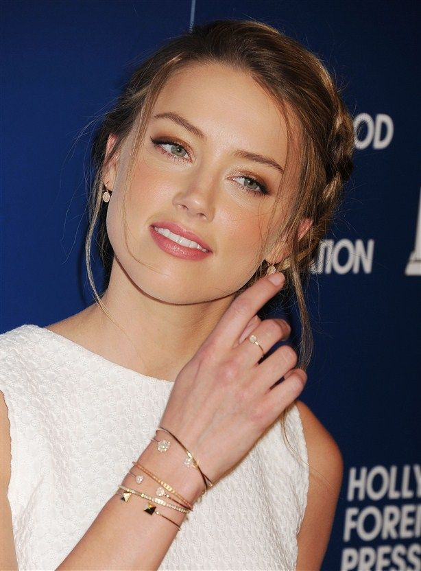 My girl crush ~ Amber Heard.  Love her!  I ran into her in Miami  almost died, she's mind-blowingly beautiful in person. Not just Totally stunning but also Tall.  Lucky girl!