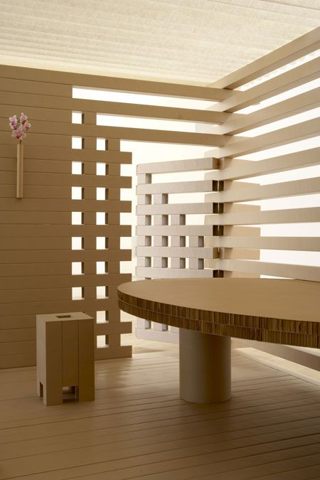 A Shigeru Ban tea house, constructed of square paper tubes, is a structure designed for indoor use measuring just over 5 meters long. Housing a table and four stools, the house also features a waiting area with a bench in keeping with tea ceremony practice.