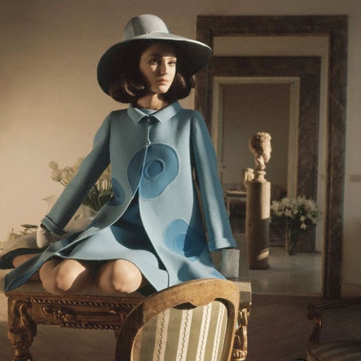 Benedetta Barzini (ca.1968) in the apartment of Cy Twombly, wearing blue coat with circular pattern and matching hat by Mila Schoen. Photo by Henry Clarke for Vogue. © Condé Nast Archive/CORBIS