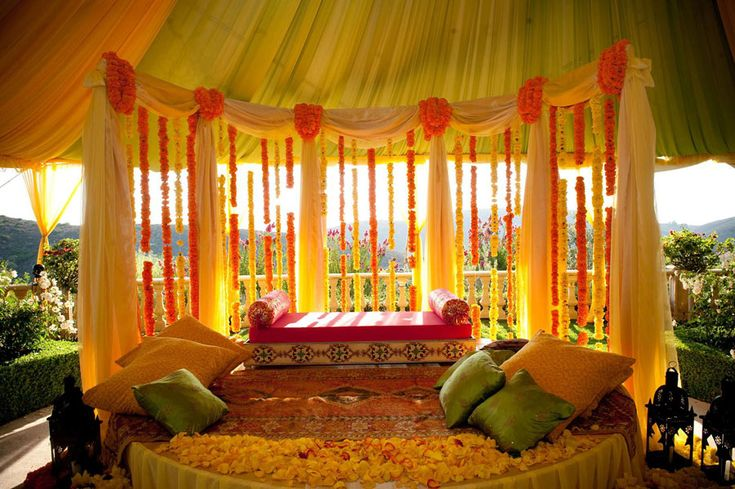 Yellow orange mehndi sangeet pre wedding decor for Sangeet decorations at home