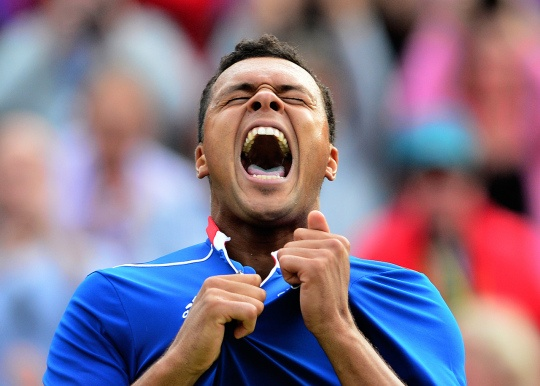 France's Jo-Wilfried Tsonga celebrates after winning over Canada's Milos Raonic during their men's singles tennis match second round at the 2012 London Olympic Games at the All England Tennis Club in Wimbledon, southwest London, on July 31, 2012.    Credit: MARTIN BERNETTI/AFP/Getty Images