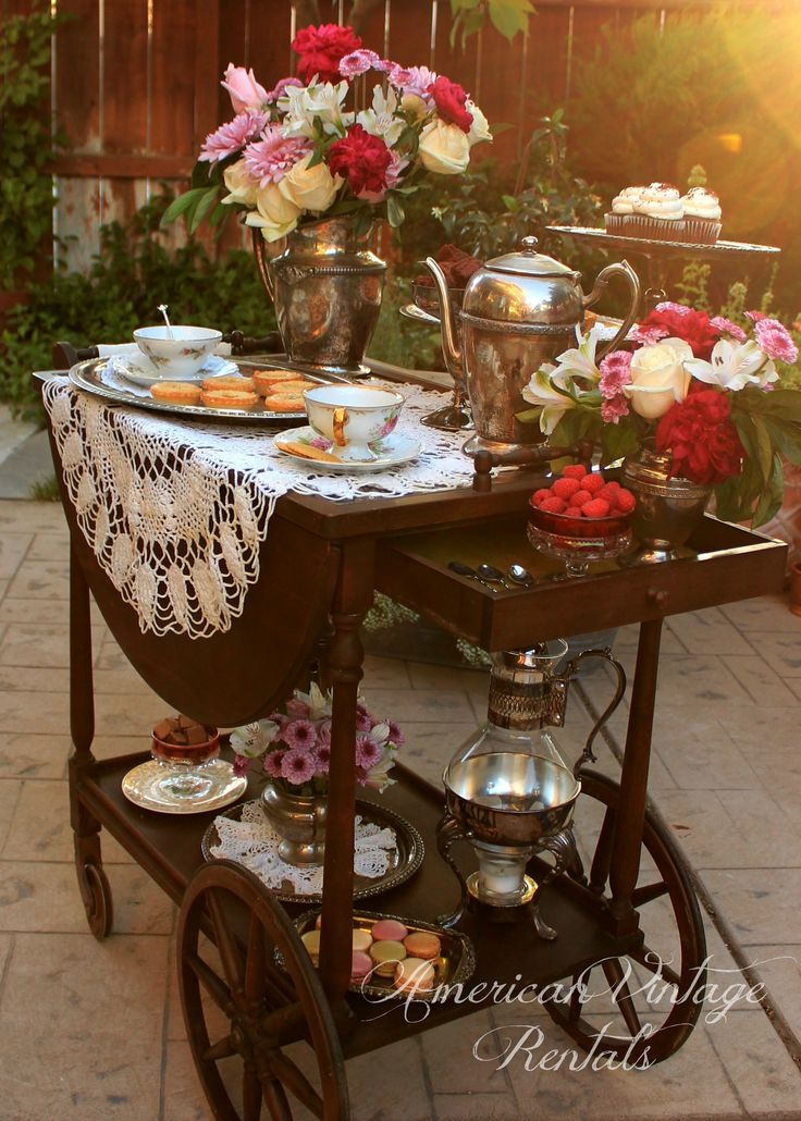 "Classic ""Downton Abbey""-style tea cart, set with silver and lace! This item available to rent from American Vintage Rentals."