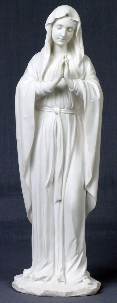 Beautiful praying Madonna statue in white to represent her purity.This praying Virgin Mary statue is from the Veronese Collection. This is a very special and high quality catholic gift. Made of a resi