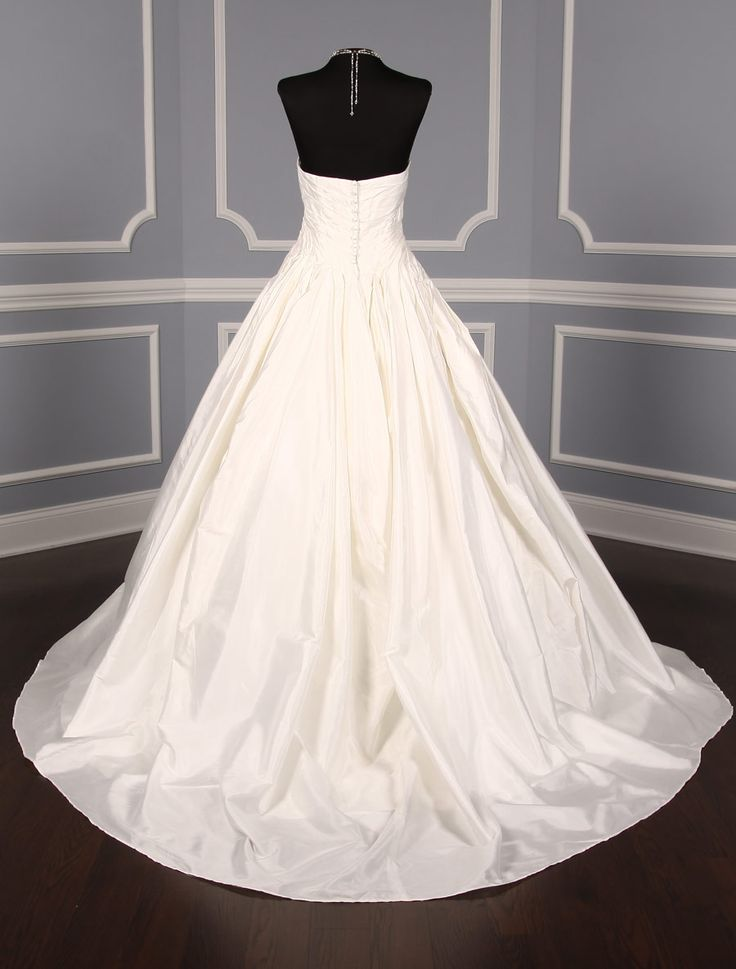 This St. Pucchi Olivia Z168 wedding dress is perfect for any wedding venue! Covered buttons along side the back zipper give this gown a clean finished and elegant look. #weddingdress