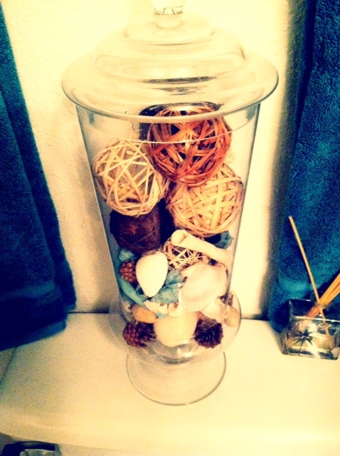 Apothecary jars are awesome. I filled this one with sea shells for color, potpourri for scent, and wicker balls for texture.