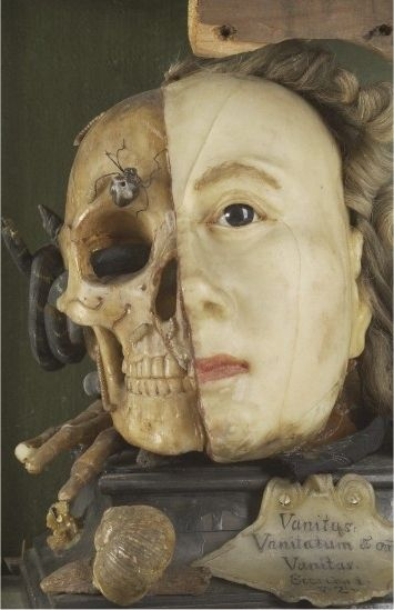 """1700s: Vanitas tableau of Queen Elizabeth I. """"A Vanitas tableau of a life sized head, on one side resembling Queen Elizabeth I, the other half a skull with attendant insects and reptiles, made from wax."""""""