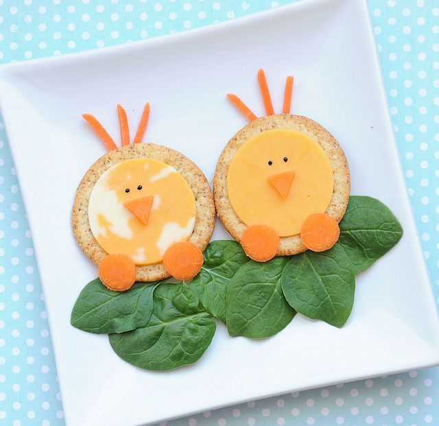 Cute! 2 lg crackers, 2 slices of cheese, 1 baby carrot, spinach leaves, black gel food coloring (for eyes)