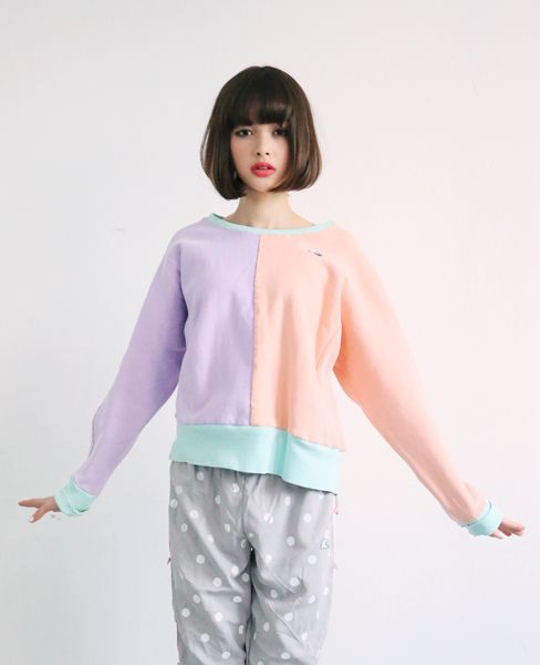 pastel purple orange green sweater with light gray pants japanese look