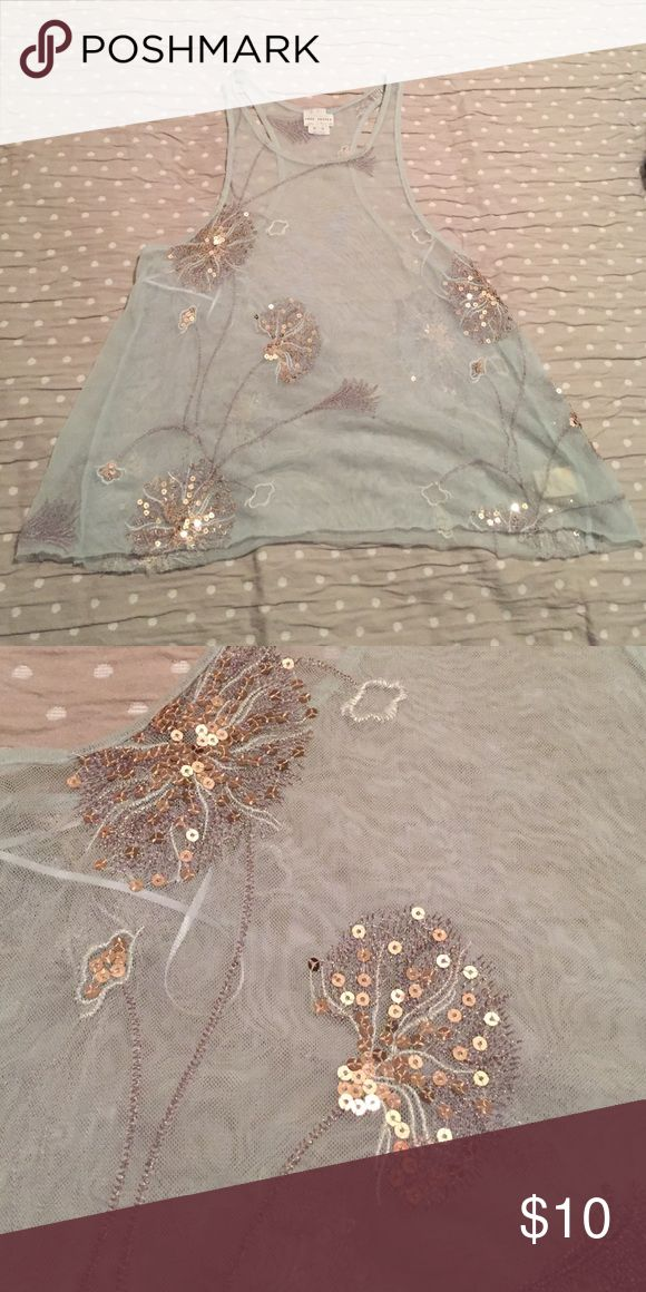 Free People Mesh Top Fun Free People Mesh Top. It has a razorback. It is loser flowing. Great for layering. Free People Tops Tank Tops
