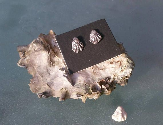 These little sterling silver oyster stud earrings were molded from a real tiny oyster shell. The posts and the butterfly backs are sterling silver as well. They are just under 1/2 inch long (12mm) and 1/3 inch wide (8mm). They come in a gift box and would make a fine present for a