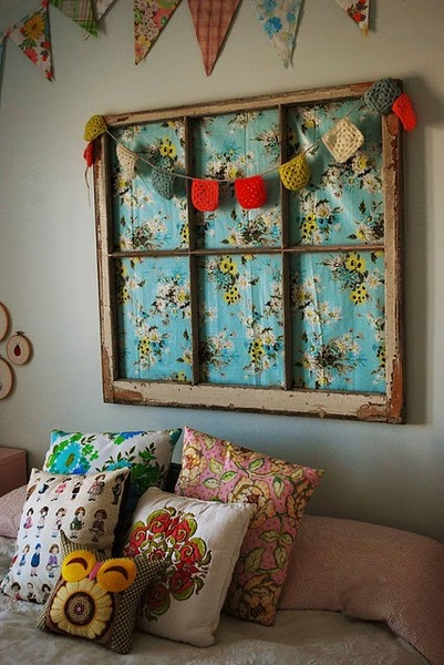 old window frame with material behind. Great idea for headboard. Could use papers instead of fabric.