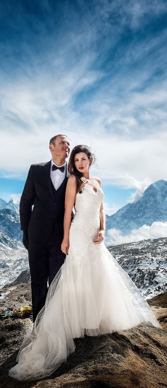 Bride and groom posing against the breathtaking mountains in the chilly air // James Sissom and Ashley Schmieder became the FIRST couple to tie the knot at Mount Everest Base Camp, in biting cold temperatures of -20 degrees Celsius! #weddingphotography #weddingideas #mteverest