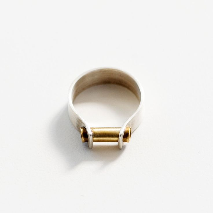 Two Tone industrial band ring- gold silver ring- modern wedding band- men's ring- mixed metal- cigar band ring by leahstaley on Etsy https://www.etsy.com/listing/231751766/two-tone-industrial-band-ring-gold