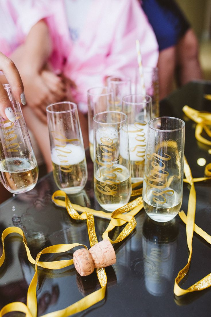 Wedding bridal prep, champagne, prosecco, fun detail shot from bridal prep. Customised prosecco glasses for bridal party.