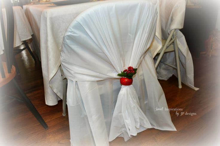 Quick and easy folding chair covers...Dollar Store rectangular plastic table cloths cut in half, drape over the top and tuck the other end through the opening in the chair. Fluff and anchor with napkin ring.