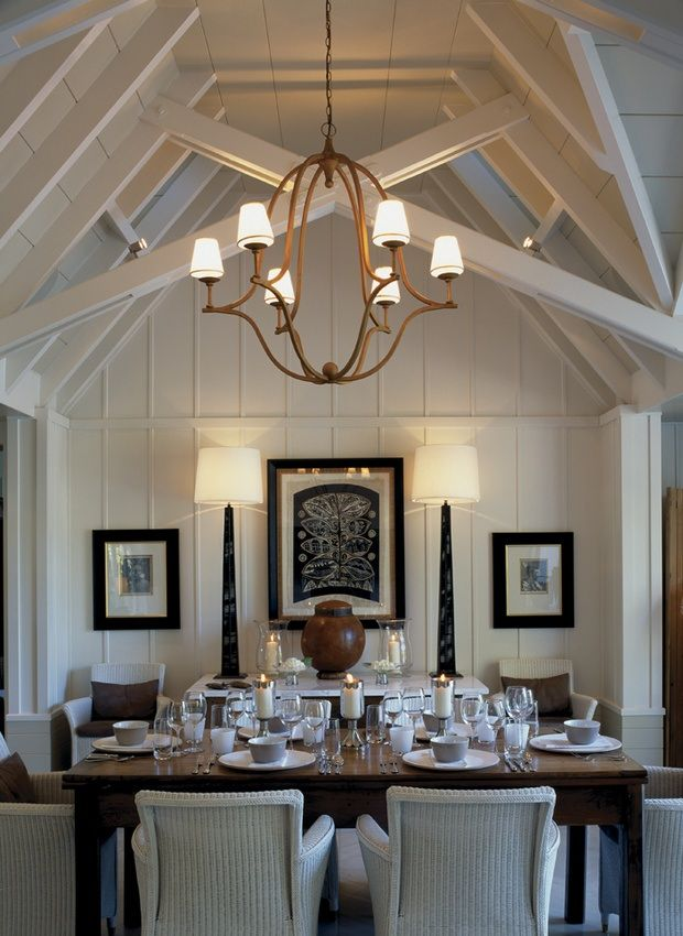 Neutral colors in the dining room of the Owner's Cottage at Huka Lodge love the art work
