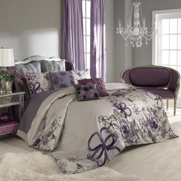 purple and grey bedroom - by keeping the walls a neutral grey you can add colour and pattern in the bed linen and accessory throw cushions.