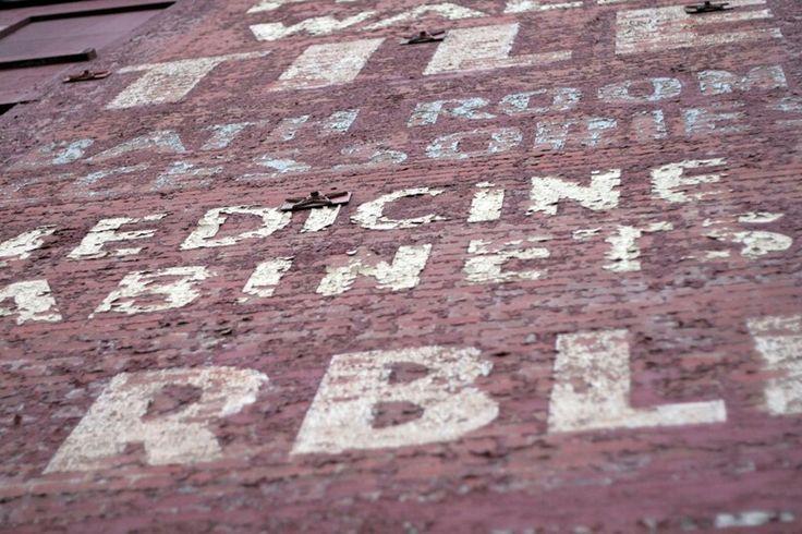 Brick facade signwritting. NYC