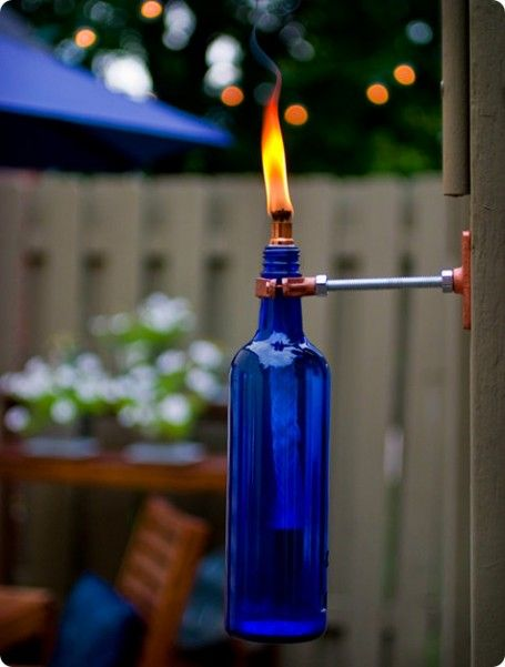 DIY Wine Bottle Torch #DIY #patiotorch #dan330 http://livedan330.com/2014/10/15/diy-wine-bottle-torch/