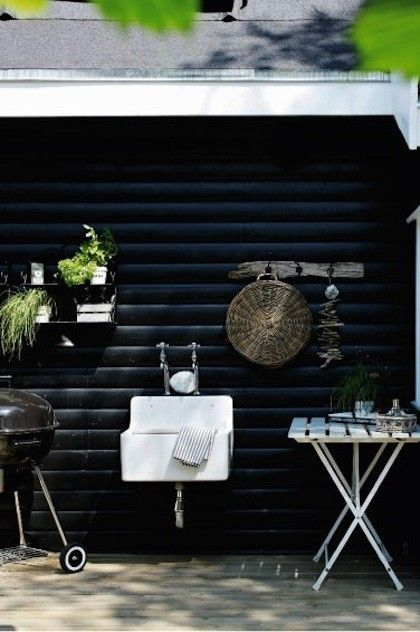 Black and white beach house in Denmark with small outdoor kitchen, Gardenista
