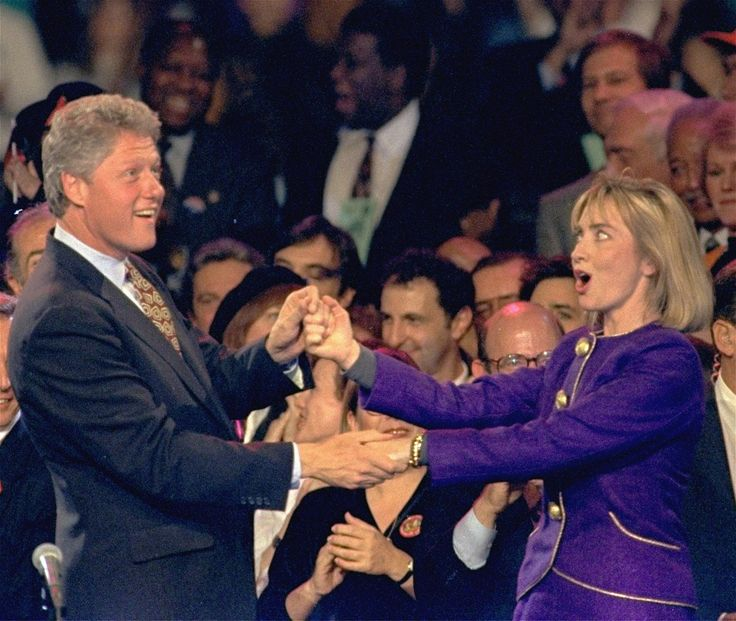 """1992 ELECTION - Democratic presidential candidate Bill Clinton and his wife Hillary dance on stage during a """"Get-Out-The-Vote"""" rally at the Brendan Byrne Arena in East Rutherford, N.J. Sunday night, Nov. 1, 1992."""