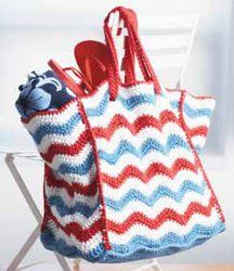 Make a red, white, and blue splash this summer with a 4th of July beach bag. You can create your very own using this #freecrochetpattern. Put your beach towel, flip flops, sunglasses, and sun screen all in this bag. #AllFreeCrochet