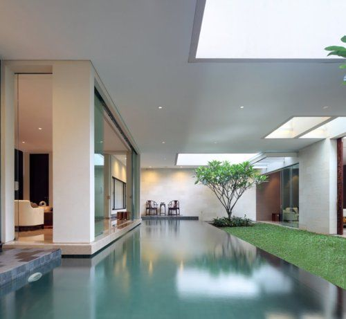 A sort-of outdoor covered infinity pool. Such an interesting setup.Indoor Pools, Water Features, Interiors Design Style, Indoor Outdoor, Static House, Home Decor, House Architecture, Modern House, House Interiors Design