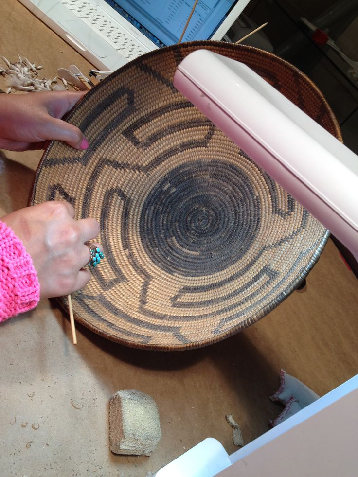 The cleaning of this historic basket was performed by Spicer Art Conservation, conservators of objects, textiles, paper and upholstered furnishings.