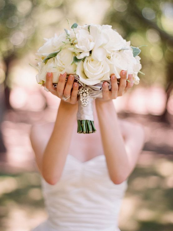 .great picture idea to remember your bouquet. I like the detail of the dress in the background. @Jackie Alexander