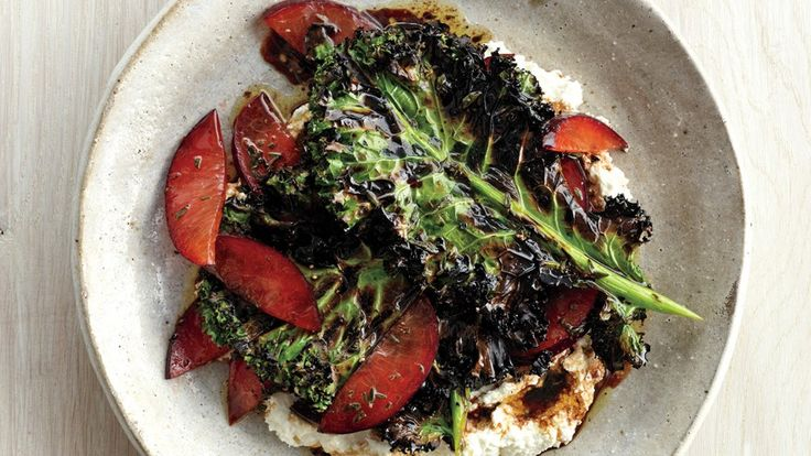 Quickly grilling kale makes it crispy. Pairing it with fresh plums and ricotta transforms it into our new favorite salad.